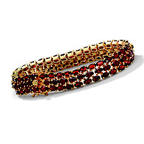 27.50 TCW Oval-Cut Garnet Triple-Row Tennis Bracelet in 14k Yellow Gold over Sterling Silver 8.5""