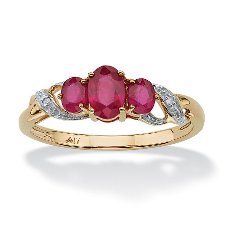 1 TCW Oval-Cut Ruby and Diamond Accent Three Stone Ring in 10k Gold at PalmBeach Jewelry