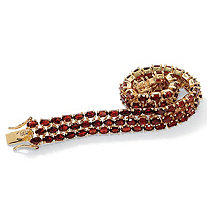 SETA JEWELRY 25 TCW Oval Cut Genuine Garnet Triple-Row Tennis Bracelet 14k Gold-Plated 7 1/4