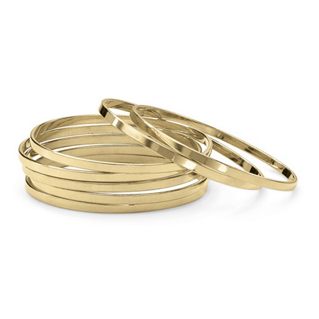 Set of 7 Bangle Bracelets in Yellow Gold Tone at PalmBeach Jewelry