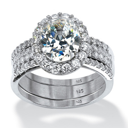 3 Piece 3.72 TCW Oval-Cut Cubic Zirconia Halo Bridal Ring Set in Platinum over Sterling Silver at PalmBeach Jewelry