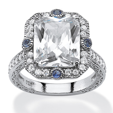 7.71 TCW Emerald-Cut Cubic Zirconia and Blue Sapphire Accent Vintage-Inspired Halo Ring in Platinum over Sterling Silver at PalmBeach Jewelry