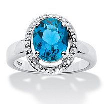 3.50 TCW Genuine Oval London Blue Topaz and Diamond Accent Halo Ring in .925 Sterling Silver