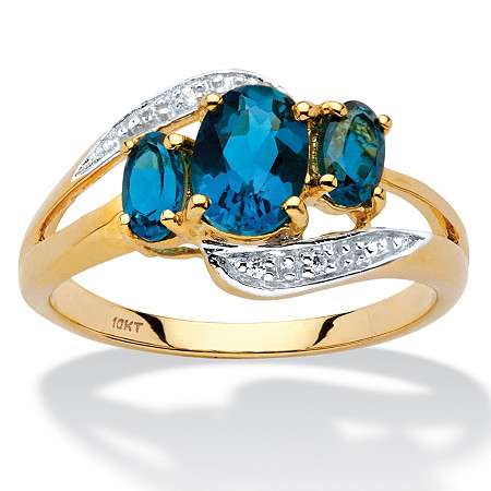 1.67 TCW Genuine London Blue Topaz and Diamond Accent Bypass Ring in 10k Yellow Gold at PalmBeach Jewelry