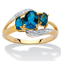 1.67 TCW Genuine London Blue Topaz and Diamond Accent Bypass Ring in 10k Yellow Gold