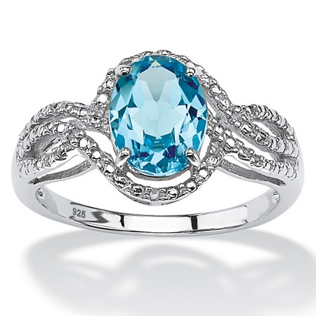 2.50 TCW Oval-Cut Genuine Blue Topaz Halo Crossover Ring in Platinum over Sterling Silver at PalmBeach Jewelry