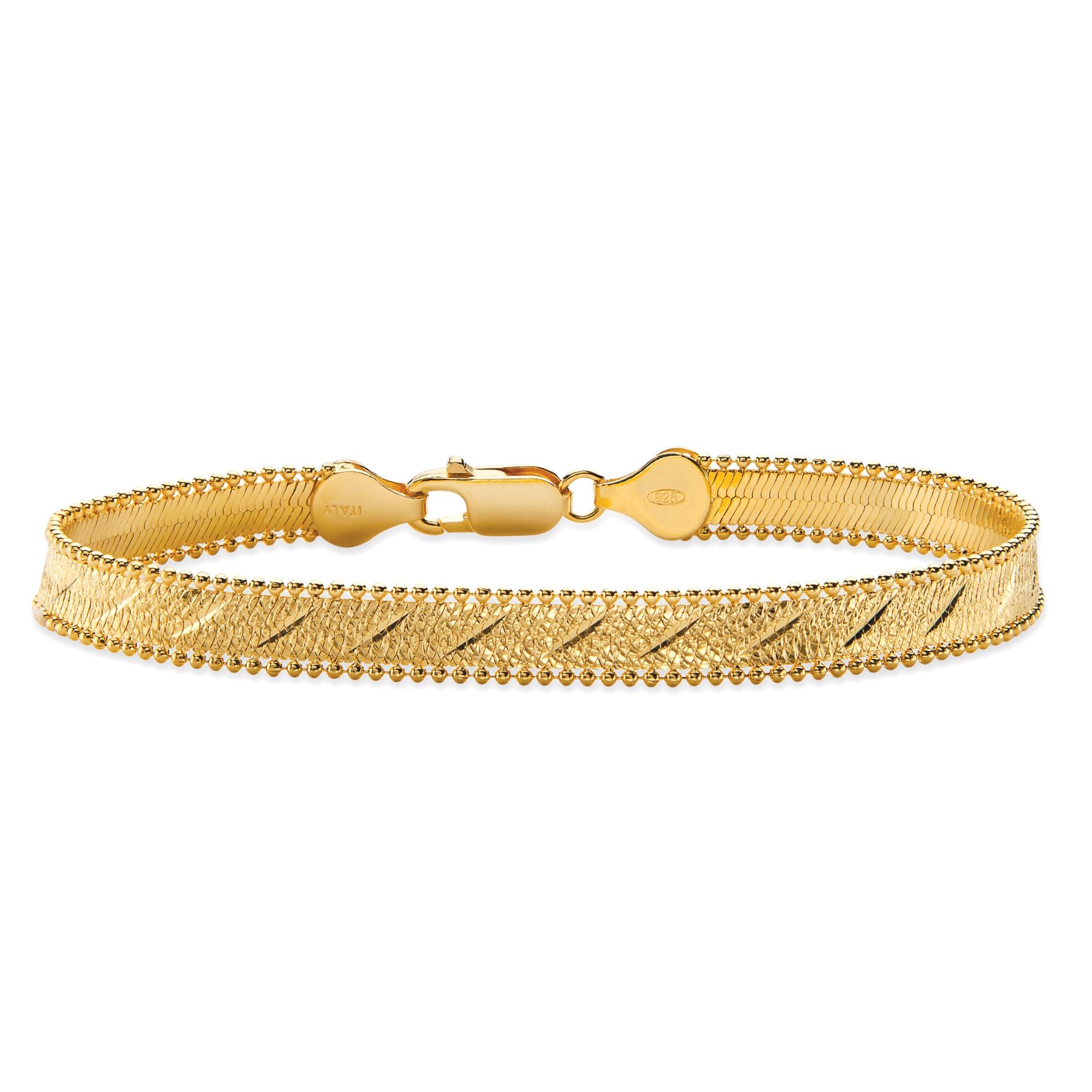 Gold And Silver Bracelets: Diamond-Cut Herringbone Bracelet In 14k Gold Over Sterling
