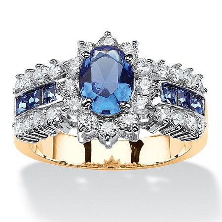 .82 TCW Oval-Cut Sapphire Blue Crystal and White Cubic Zirconia Two-Tone Halo Ring MADE WITH SWAROVSKI ELEMENTS 14k Gold-Plated at PalmBeach Jewelry