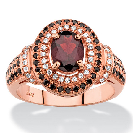 .61 TCW Oval-Cut Simulated Red Garnet Halo Cocktail Ring with Black and White CZ Accents in Rose Gold-Plated Sterling Silver at PalmBeach Jewelry