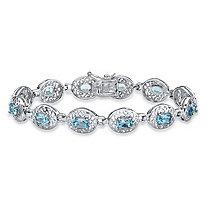 6.84 TCW Oval-Cut Genuine Blue Topaz Filigree Halo Tennis Bracelet in Sterling Silver 7