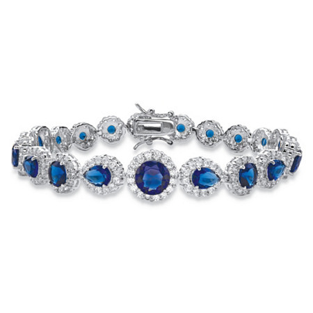 "Round and Pear-Cut Simulated Blue Sapphire and Cubic Zirconia Halo Tennis Bracelet 19.01 TCW in Silvertone 7.5"" at PalmBeach Jewelry"