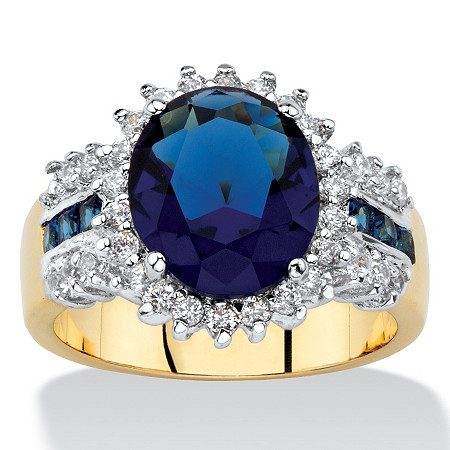 .68 TCW Oval-Cut Simulated Blue Sapphire and White Cubic Zirconia Halo Cocktail Ring 14k Yellow Gold-Plated at PalmBeach Jewelry