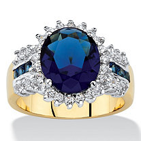 .68 TCW Oval-Cut Simulated Blue Sapphire and White Cubic Zirconia Halo Cocktail Ring 14k Yellow Gold-Plated