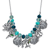 "Simulated Turquoise and Blue Crystal Ocean Themed Beaded Charm Bib Necklace in Silvertone 17""-19"""