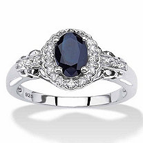 Oval-Cut Genuine Blue Sapphire and White Topaz Halo Cocktail Ring 1.12 TCW in Sterling Silver