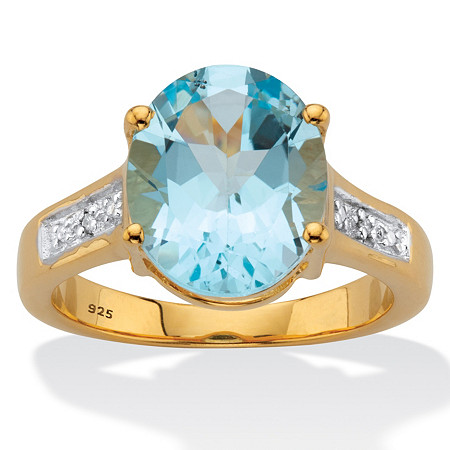 Oval-Cut Classic Blue Topaz and Diamond Accent Two-Tone Ring 6.01 TCW 14k Gold over Sterling Silver at PalmBeach Jewelry